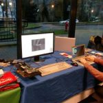 Photo of FOSDEM booth with Tobias
